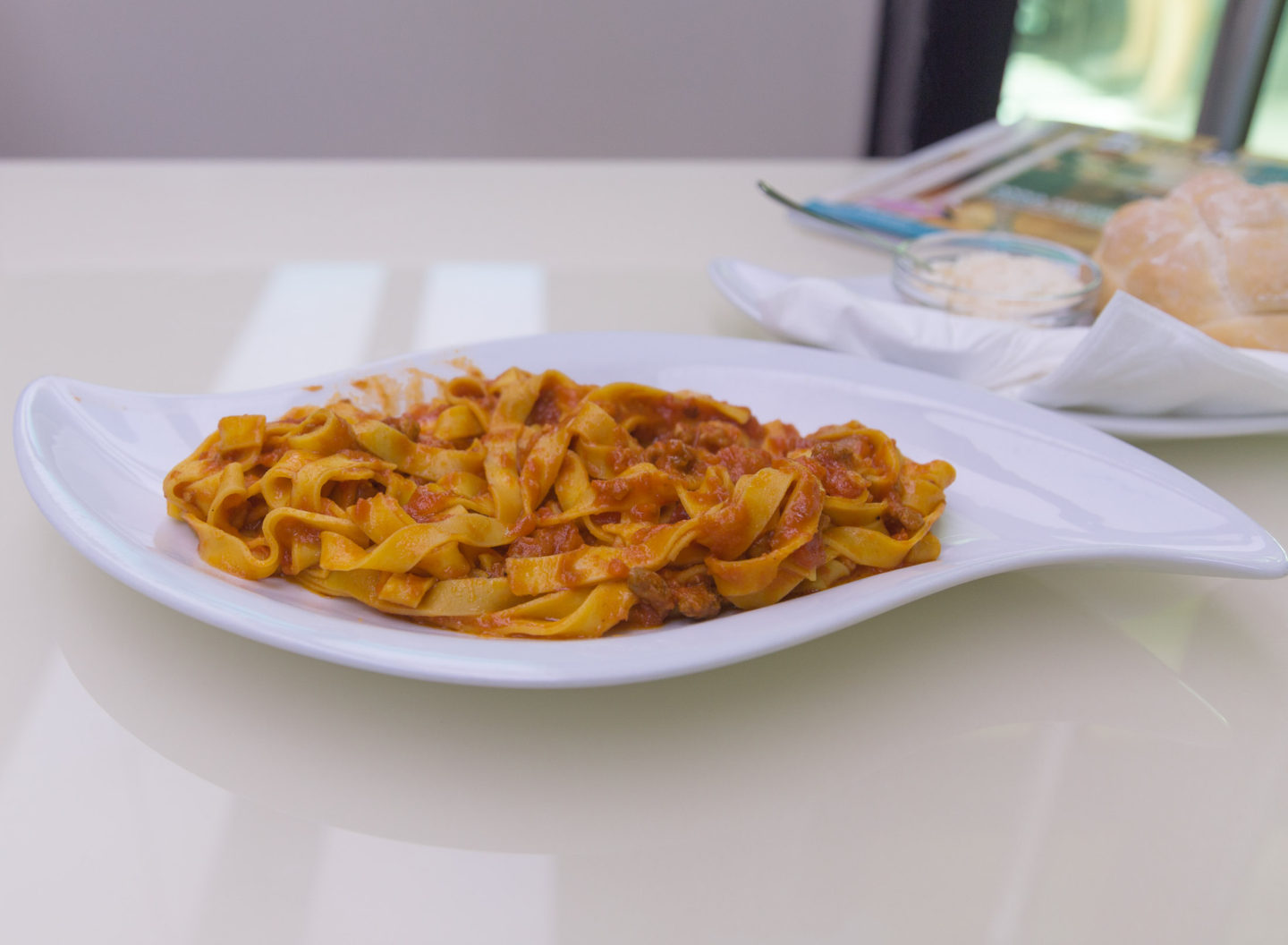 flat noodle pasta with bolognese sauce